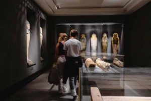 man-and-woman-across-mummies